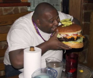 East 6 Fat-guy-eating-giant-hamburger