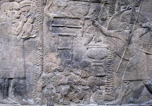 Асирійські чиновники рахують відрубані голови переможених